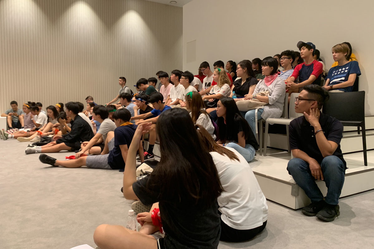 Students listening to a presentation at the National Museum of Korea.