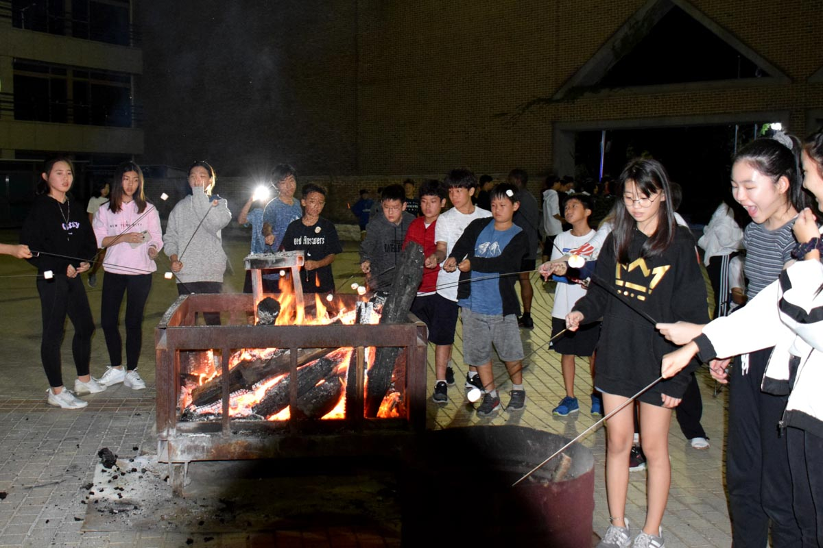 Students enjoying the bonfire.