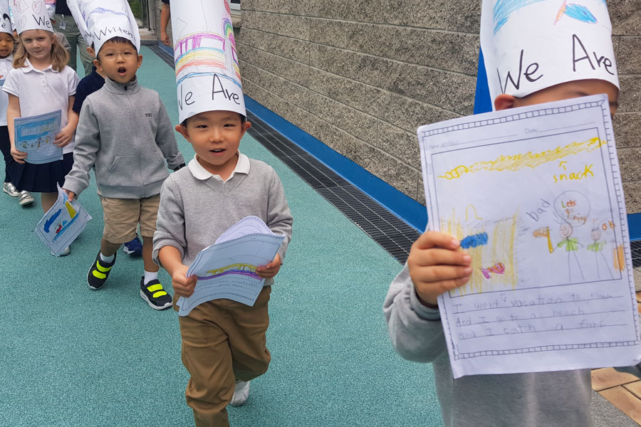 Kindergarten students parading around the YISS campus.