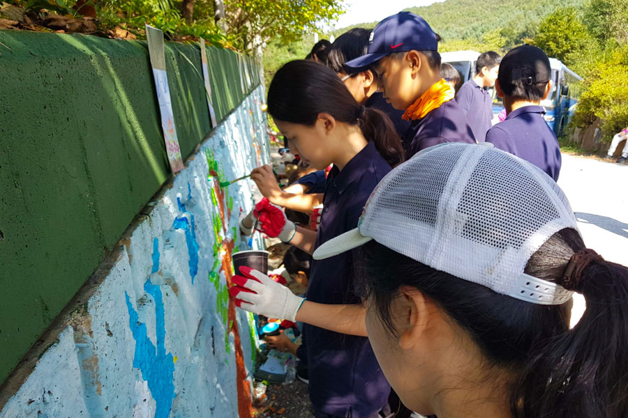 Students painting a mural.