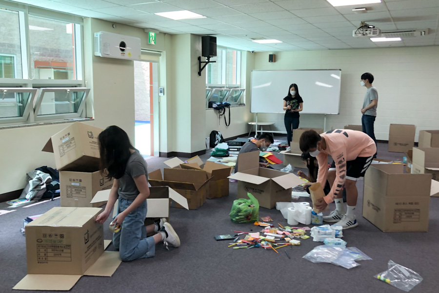 Students packing boxes for donations